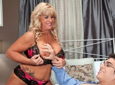 The 51-year-old cougar takes a 21-year-old cock in her ass